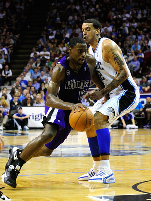ORLANDO, FL - JANUARY 22:  Tyreke Evans #13 of the Sacramento Kings drives against Matt Barnes #22 of the Orlando Magic during the game at Amway Arena on January 22, 2010 in Orlando, Florida. NOTE TO USER: User expressly acknowledges and agrees that, by d