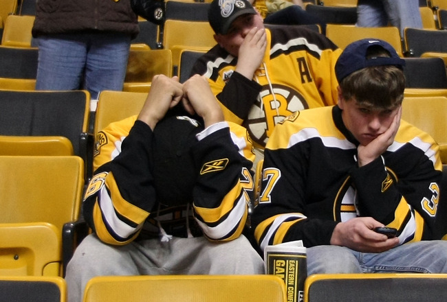 BOSTON - MAY 14:  Boston Bruins fans react after their team lost to the Philadelphia Flyers in Game Seven of the Eastern Conference Semifinals during the 2010 NHL Stanley Cup Playoffs at TD Garden on May 14, 2010 in Boston, Massachusetts. The Flyers defea