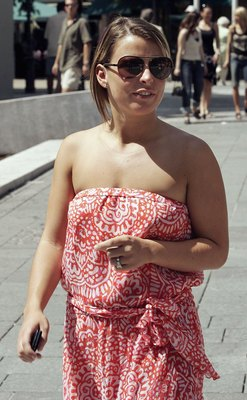 BADEN BADEN, GERMANY - JUNE 18:  Fiancee of England striker Wayne Rooney, Coleen McLoughlin walks in the shopping district of Baden Baden on June 18, 2006 in Germany.  (Photo by Peter Macdiarmid/Getty Images)