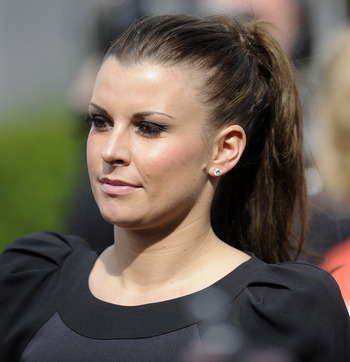 LIVERPOOL, ENGLAND - APRIL 09: Coleen Rooney arrives at Aintree racecourse on April 09, 2010 in Liverpool, England  (Photo by Alan Crowhurst/ Getty Images)
