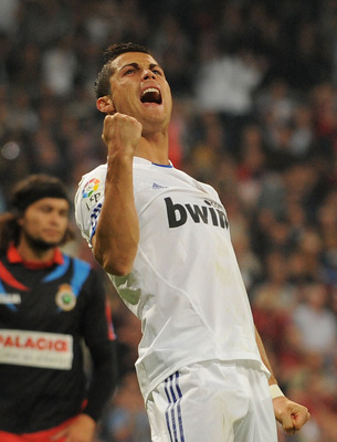 MADRID, SPAIN - OCTOBER 23:  Cristiano Ronaldo of Real Madrid celebrates after scoring Real's 5th goal during the La Liga match between Real Madrid and Racing Santander at Estadio Santiago Bernabeu on October 23, 2010 in Madrid, Spain.  (Photo by Denis Do