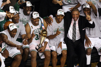 BOSTON - JUNE 17:  (L-R) Glen Davis #11, Kevin Garnett #5, Paul Pierce #34, Ray Allen #20 and head coach Doc Rivers of the Boston Celtics celebrate after defeating the Los Angeles Lakers in Game Six of the 2008 NBA Finals on June 17, 2008 at TD Banknorth