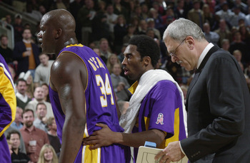 SEATTLE - NOVEMBER 30:  Center Shaquille O'Neal #34 of the Los Angeles Lakers stands on the sideline with guard Kobe Bryant #8 and head coach Phil Jackson during the NBA game against the Seattle SuperSonics at Key Arena in Seattle, Washington on November