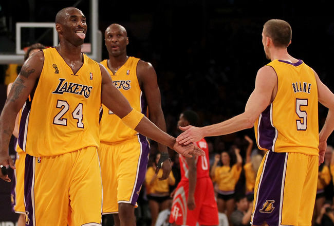 LOS ANGELES, CA - OCTOBER 26:  Kobe Bryant #24 of the Los Angeles Lakers and Steve Blake #5 celebrate scoring against the Houston Rockets during their opening night game at Staples Center on October 26, 2010 in Los Angeles, California. NOTE TO USER: User