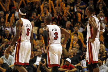 MIAMI - OCTOBER 29:  Guard Dwyane Wade #3, forward Chris Bosh #1 and forward LeBron James #6 of  the Miami Heat take on the Orlando Magic at American Airlines Arena on October 29, 2010 in Miami, Florida. NOTE TO USER: User expressly acknowledges and agree