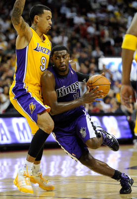 LAS VEGAS - OCTOBER 13:  Tyreke Evans #13 of the Sacramento Kings drives against Matt Barnes #9 of the Los Angeles Lakers during their preseason game at the Thomas & Mack Center October 13, 2010 in Las Vegas, Nevada. The Lakers won 98-95. NOTE TO USER: Us