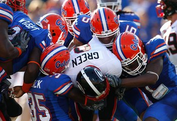JACKSONVILLE, FL - OCTOBER 31:  The Florida Gators defense tackles A.J. Green #8 of the Georgia Bulldogs at Jacksonville Municipal Stadium on October 31, 2009 in Jacksonville, Florida.  (Photo by Kevin C. Cox/Getty Images)