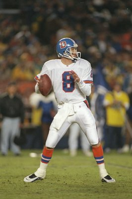 22 Dec 1996: Quarterback Jeff Lewis of the Denver Broncos drops back to pass during a game against the San Diego Chargers at Jack Murphy Stadium in San Diego, California. The Chargers won the game 16-10.