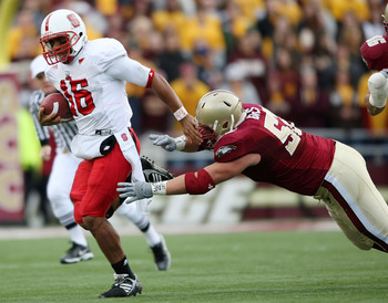 CHESTNUT HILL, MA - OCTOBER 17:  Russell Wilson #16 of the North Carolina State Wolf Pack  scrambles as Austin Giles #52 of the Boston College Eagles defends on October 17, 2009 at Alumni Stadium in Chestnut Hill, Massachusetts.  (Photo by Elsa/Getty Imag