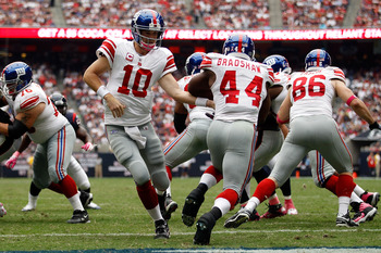 HOUSTON - OCTOBER 10:  Eli Manning #10 hands off the ball to Ahmad Bradshaw #44 of the New York Giant during the game against the Houston Texans at Reliant Stadium on October 10, 2010 in Houston, Texas.  The Giants defeated the Texans 34-10.  (Photo by Ch