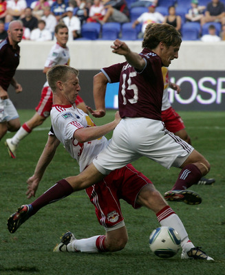 HARRISON, NJ - SEPTEMBER 11: Tim Ream #5 of the New York Red Bulls and Wells Thompson #15 of the Colorado Rapids battle hard for a loose ball during the game at Red Bull Arena on September 11, 2010 in Harrison, New Jersey. (Photo by Andy Marlin/Getty Imag