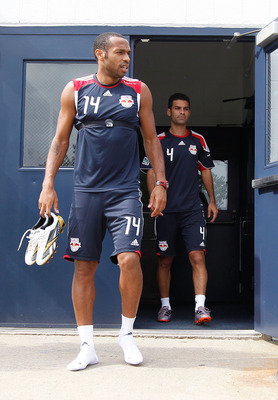 MONTCLAIR, NJ - AUGUST 03:  Rafa Marquez #4 and Thierry Henry #14 of the New York Red Bulls arrive for practice at Montclair State University on August 3, 2010 in Montclair, New Jersey.  (Photo by Mike Stobe/Getty Images for New York Red Bulls)