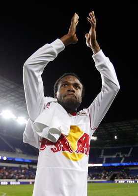 HARRISON, NJ - OCTOBER 21:  Dane Richards #19 of the New York Red Bulls salutes the crowd after defeating the New England Revolution 2-0 on October 21, 2010 at Red Bull Arena in Harrison, New Jersey.  (Photo by Mike Stobe/Getty Images for New York Red Bul