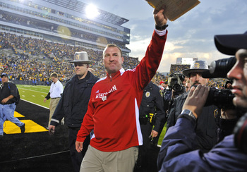 IOWA CITY, IA - OCTOBER 23: Wisconsin Badgers head coach Bret Bielema waves to fans after after his victory over the University of Iowa Hawkeyes at Kinnick Stadium on October 23, 2010 in Iowa City, Iowa. Wisconsin won 31-30 over Iowa. (Photo by David Purd