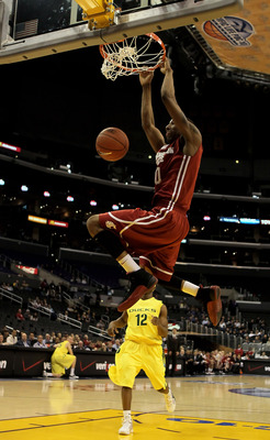 LOS ANGELES, CA - MARCH 10:  Marcus Capers #0 of the Washington State Cougars dunks the ball against the Oregon Ducks in the half during the first round of the Pac-10 Basketball Tournament at Staples Center on March 10, 2010 in Los Angeles, California.  (