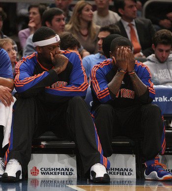 NEW YORK - DECEMBER 07:  Eddy Curry #34 of the New York Knicks sits with teammate Nate Robinson #2 on the bench during NBA action against the Portland Trail Blazers at Madison Square Garden on December 7, 2009 in New York, New York. NOTE TO USER: User exp
