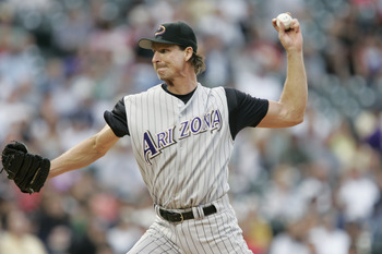 DENVER - JULY 30:  Randy Johnson #51 of the Arizona Diamondbacks throws against the Colorado Rockies on July 30, 2004 at Coors Field in Denver, Colorado.  The Rockies defeated the Diamondbacks 4-1.  (Photo by Brian Bahr/Getty Images)