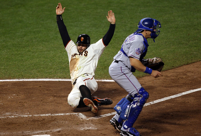 SAN FRANCISCO - OCTOBER 28:  Cody Ross #13 of the San Francisco Giants slides home safely to score a run in the seventh inning before the tag of Matt Treanor #15 of the Texas Rangers in Game Two of the 2010 MLB World Series at AT&T Park on October 28, 201
