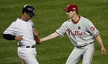 Philadelphia-phillies-starting-pitcher-cliff-lee-tags-out-new-york-yankees-jorge-posada-in-the-seventh-inning-in-game-1-of-the-world-series-at-yankee-stadium-in-new-york_13_display_image