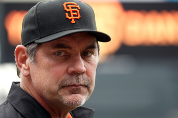 SAN FRANCISCO - OCTOBER 28:  Manager Bruce Bochy of the San Francisco Giants looks on during batting practice before Game Two of the 2010 MLB World Series against the Texas Rangers at AT&T Park on October 28, 2010 in San Francisco, California.  (Photo by