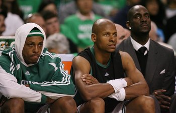 BOSTON - APRIL 18:  Paul Pierce #34, Ray Allen #20 and Kevin Garnett #5  of the Boston Celtics look on from the bench against the Chicago Bulls in Game One of the Eastern Conference Quarterfinals during the 2009 NBA Playoffs at TD Banknorth Garden on Apri
