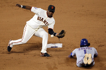 SAN FRANCISCO - OCTOBER 28:  Elvis Andrus #1 of the Texas Rangers steals second base as the ball gets away from Edgar Renteria #16 of the San Francisco Giants in the eighth inning of Game Two of the 2010 MLB World Series at AT&T Park on October 28, 2010 i