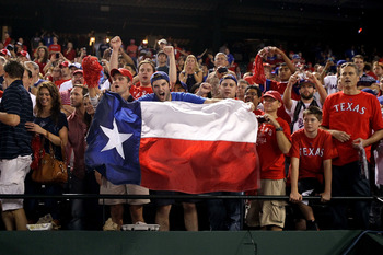 ARLINGTON, TX - OCTOBER 22:  Fans of the Texas Rangers holds a Texas state flag during Game Six of the ALCS against the New York Yankees during the 2010 MLB Playoffs at Rangers Ballpark in Arlington on October 22, 2010 in Arlington, Texas.  (Photo by Step