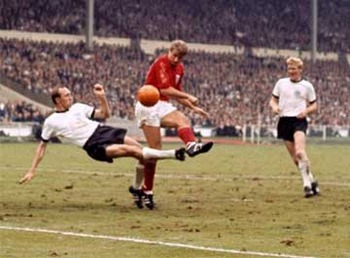 Any-s-willi-schulz-challenges-england-s-roger-hunt-watched-by-teammate-karl-heinz-schnelling-and-england-s-alan-ball-during-the-1966-world-cu-704747568_display_image