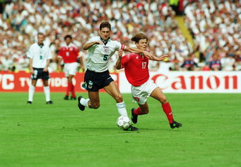 LONDON - JUNE 8:  Johann Vogel of Switzerland is blocked off by Tony Adams of England during the UEFA European Championships 1996 Group A match between England and Switzerland held on June 8, 1996 at Wembley, in London. The match ended in a 1-1 draw. (Pho