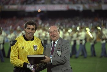 16 Jun 1990:  Peter Shilton (left) of England is awarded his 125th and World Record England Cap by Sir Bert Millichip (right) before the World Cup match against Holland in Cagliari, Italy. The match ended in a 0-0 draw. \ Mandatory Credit: David  Cannon/A