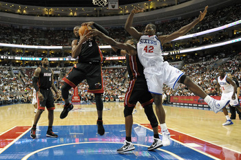 PHILADELPHIA - OCTOBER 27:  Dwyane Wade #3 of the Miami Heat grabs a rebound away from Elton Brand #42 of the Philadelphia 76ers at the Wells Fargo Center on October 27, 2010 in Philadelphia, Pennsylvania. NOTE TO USER: User expressly acknowledges and agr