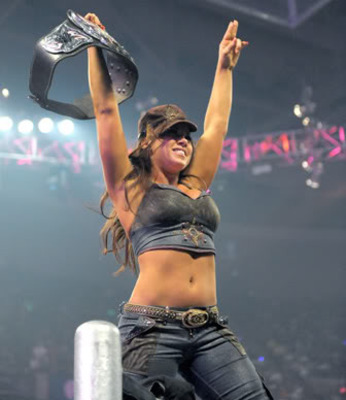 Mickie James as Divas champion, photo copyright to WWE.com