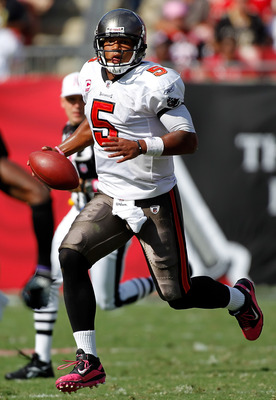 TAMPA, FL - OCTOBER 17:  Quarterback Josh Freeman #5 of the Tampa Bay Buccaneers runs the ball against the New Orleans Saints during the game at Raymond James Stadium on October 17, 2010 in Tampa, Florida.  (Photo by J. Meric/Getty Images)