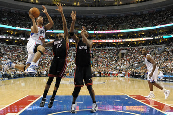 PHILADELPHIA - OCTOBER 27:  Evan Turner #12 of the Philadelphia 76ers goes up for a shot past James Jones #22 and Chris Bosh #1 of the Miami Heat at the Wells Fargo Center on October 27, 2010 in Philadelphia, Pennsylvania. NOTE TO USER: User expressly ack