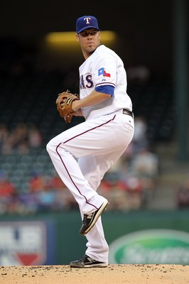 ARLINGTON, TX - MAY 11:  Pitcher Colby Lewis #48 of the Texas Rangers throws against the Oakland Athletics on May 11, 2010 at Rangers Ballpark in Arlington, Texas.  (Photo by Ronald Martinez/Getty Images)