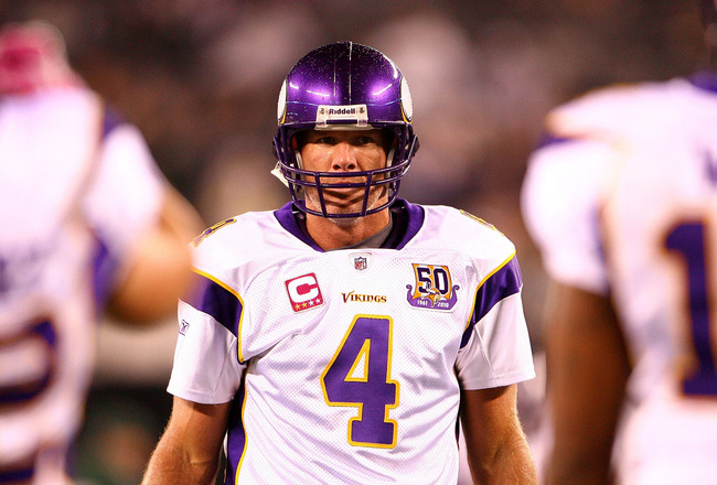 EAST RUTHERFORD, NJ - OCTOBER 11:  Quarterback Brett Favre #4 of the Minnesota Vikings looks on against the New York Jets at New Meadowlands Stadium on October 11, 2010 in East Rutherford, New Jersey.  (Photo by Andrew Burton/Getty Images)