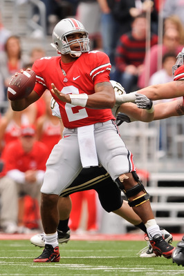 COLUMBUS, OH - OCTOBER 23:  Terrelle Pryor #2 of the Ohio State Buckeyes drops back to pass against the Purdue Boilermakers at Ohio Stadium on October 23, 2010 in Columbus, Ohio.  (Photo by Jamie Sabau/Getty Images)