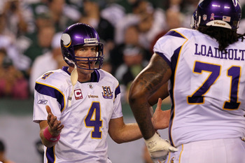 EAST RUTHERFORD, NJ - OCTOBER 11:  Quarterback Brett Favre #4 of the Minnesota Vikings gestures in the huddle in the first half against the New York Jets at New Meadowlands Stadium on October 11, 2010 in East Rutherford, New Jersey.  (Photo by Jim McIsaac