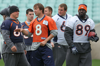LONDON, ENGLAND - OCTOBER 29:  Quarterback Kyle Orton #8 of the Denver Broncos talks with team mates during a team training session at The Brit Oval on October 29, 2010 in London, England. The Denver Broncos will play the San Francisco 49ers at Wembley St