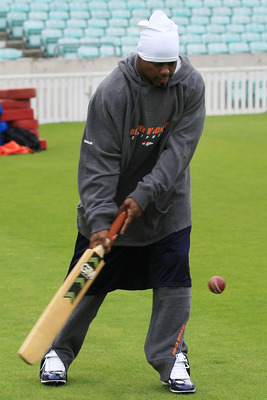 LONDON, ENGLAND - OCTOBER 29: Brian Dawkins of the Denver Broncos plays cricket prior to the start of  a team training session at The Brit Oval on October 29, 2010 in London, England. The Denver Broncos will play the San Francisco 49ers at Wembley Stadium