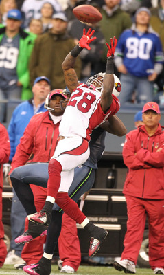 SEATTLE - OCTOBER 24:  Cornerback Greg Toler #28 of the Arizona Cardinals tries to intercept a pass against wide receiver Mike Williams #17 of the Seattle Seahawks at Qwest Field on October 24, 2010 in Seattle, Washington. (Photo by Otto Greule Jr/Getty I