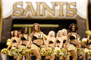 NEW ORLEANS - SEPTEMBER 26:  Mmebers of the Saintsations dance team perform before the game between the New Orleans Saints and the Atlanta Falcons at the Louisiana Superdome on September 26, 2010 in New Orleans, Louisiana.  (Photo by Chris Graythen/Getty