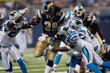 ST. LOUIS, MO - SEPTEMBER 9:  Steven Jackson #39 of the St. Louis Rams runs the ball through the defense of the Carolina Panthers during the NFL game on September 9, 2007 at the Edward Jones Dome in St. Louis, Missouri.  The Panthers beat the Rams 27-13.