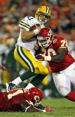 KANSAS CITY, MO - SEPTEMBER 02:  Starting quarterback Matt Flynn #10 of the Green Bay Packers is sacked by Dion Gales #70 of the Kansas City Chiefs during the game on September 2, 2010 at Arrowhead Stadium in Kansas City, Missouri.  (Photo by Jamie Squire
