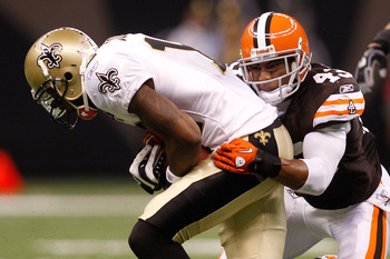 NEW ORLEANS - OCTOBER 24:  Marques Colston #12 of the New Orleans Saints is tackled by T.J. Ward #43 of the Cleveland Browns at the Louisiana Superdome on October 24, 2010 in New Orleans, Louisiana.  (Photo by Chris Graythen/Getty Images)