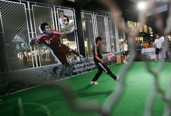 BEIJING, CHINA - AUGUST 13: (CHINA OUT) Residents play football games to win Olympic Games tickets during a competition held in an Adidas flagship store August 13, 2008 in Beijing, China. The Beijing Olympic Games entered its fifth day on August 13. (Phot