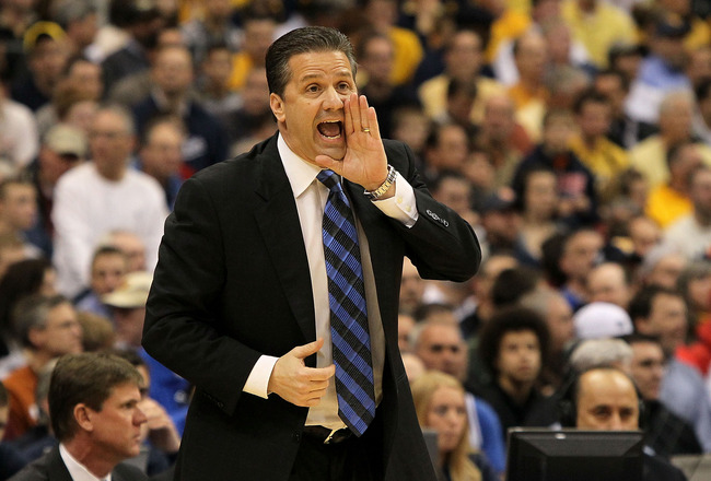 SYRACUSE, NY - MARCH 27:  Head coach John Calipari of the Kentucky Wildcats reacts against the West Virginia Mountaineers during the east regional final of the 2010 NCAA men's basketball tournament at the Carrier Dome on March 27, 2010 in Syracuse, New Yo