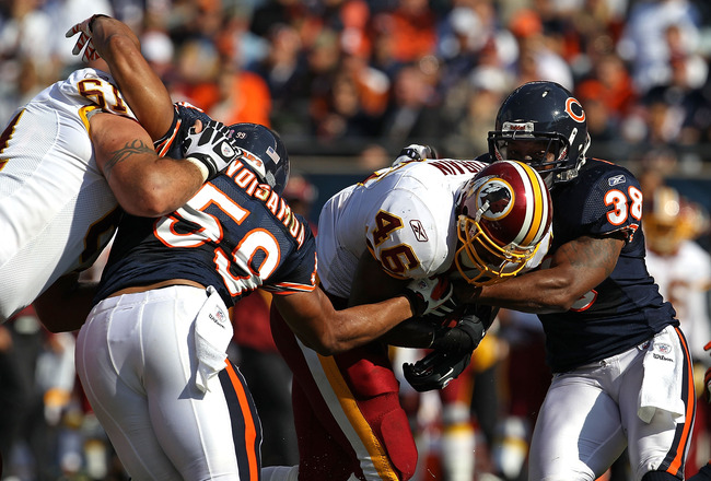 CHICAGO - OCTOBER 24: Ryan Torain #46 of the Washington Redskins is tackled by Charles Tillman #33 and Pisa Tinoisamoa #59 of the Chicago Bears at Soldier Field on October 24, 2010 in Chicago, Illinois. The Redskins defeated the Bears 17-14. (Photo by Jon