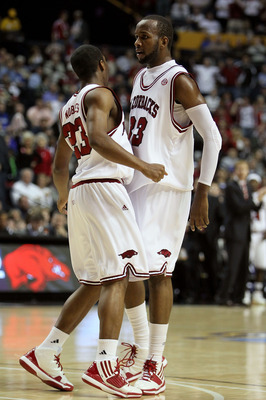 NASHVILLE, TN - MARCH 11:  (L-R) Julysses Nobles #23 and Marshawn Powell #33 of the Arkanasas Razorbacks react to a play against the Georgia Bulldogs during the first round of the SEC Men's Basketball Tournament at the Bridgestone Arena on March 11, 2010