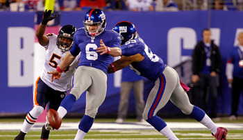 EAST RUTHERFORD, NJ - OCTOBER 03:  Matt Dodge #6 of the New York Giants punts the after bobbling the snap against Nick Roach #53 of the Chicago Bears at New Meadowlands Stadium on October 3, 2010 in East Rutherford, New Jersey.  (Photo by Michael Heiman/G